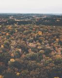 Drone image of a multicolored forest in the Southeastern United States with fall foliage. This was shot in rural Alabama with rolling hills. The rich autumn stock images