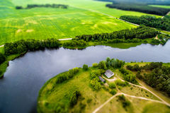 Drone image. A view from above on a natural lake, road and field. Drone image of countryside. A view from above on a natural lake, road and meadow Royalty Free Stock Photography