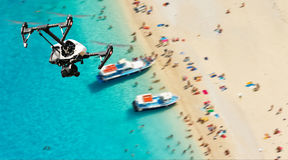 Drone for industrial works flying above beach Royalty Free Stock Photo