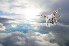 Drone for industrial works flying above clouds Stock Image