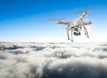 Drone for industrial works flying above clouds Royalty Free Stock Image