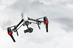 Drone with 4K camera flying. royalty free stock images