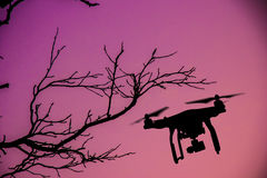 Drone with 4K camera flying. Royalty Free Stock Photos