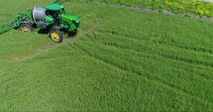 4K Drone Aerial Farm Tractor Enters And Exits Frame stock video
