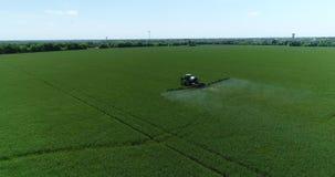4K Drone Aerial Farm Tractor Spraying Grassland Pan Follow stock video