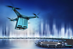 Drone with metal container at flight over heliport Stock Photo