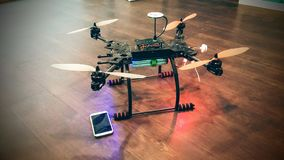 Drone and mobile. Phone on the floor Royalty Free Stock Photo