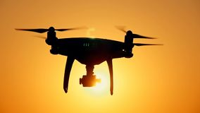 Drone moves in the air against the sunset background stock video footage