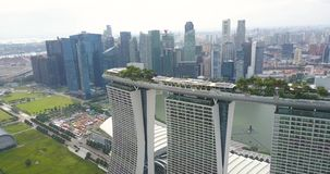 Aerial view of Marina Bay Sands hotel and financial district in Singapore stock video footage