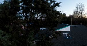 Drone Landing In Front Of Suburban House Near Dusk stock footage