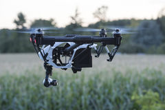 Drone at nightfall. Flying quadrocopter drone with camera stock image