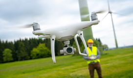 Free Drone Operated By Construction Worker Inspecting Wind Turbine Stock Photos - 153835483
