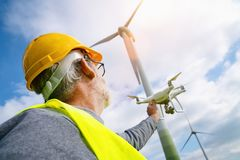 Free Drone Operated By Construction Worker Inspecting Wind Turbine Royalty Free Stock Image - 153835526
