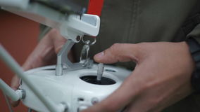 Drone operator holding a transmitter. Quadcopter operator holding a transmitter stock video