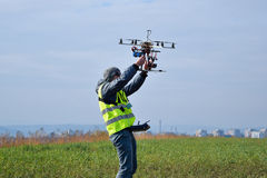 Drone operator. Drone over airport runway with operator royalty free stock images
