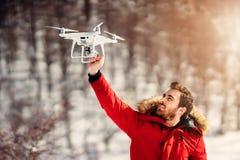 Drone operator, drone pilot holding small compact drone stock photo