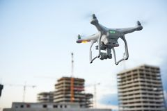 Drone over construction site. video surveillance or industrial inspection. Drone hovering over construction site. video surveillance or industrial inspection stock photo