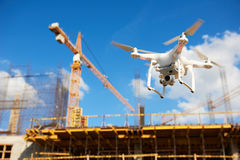 Drone over construction site. video surveillance or industrial inspection. Drone hovering over construction site. video surveillance or industrial inspection royalty free stock photo
