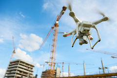 Drone over construction site. video surveillance or industrial inspection. Drone hovering over construction site. video surveillance or industrial inspection royalty free stock image