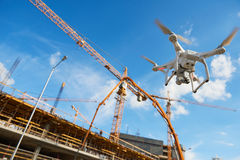 Drone over construction site. video surveillance or industrial inspection. Drone hovering over construction site. video surveillance or industrial inspection royalty free stock photography