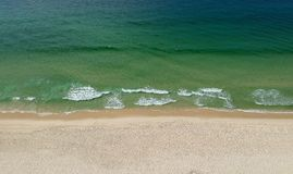 Drone panorama of Barra da Tijuca beach, Rio de Janeiro, Brazil. Drone photo of Barra da Tijuca beach, Rio de Janeiro, Brazil. We can see a relaxing view of the royalty free stock image