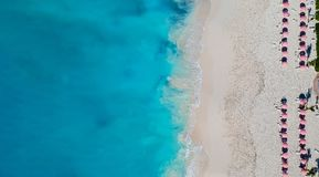 Drone panorama of beach with red umbrellas in Grace Bay, Provide. Nciales, Turks and Caicos Royalty Free Stock Photography