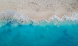 Drone panorama Grace Bay, Providenciales, Turks and Caicos. Drone photo of Grace Bay, Providenciales, Turks and Caicos. Only the caribbean blue sea and white Royalty Free Stock Photo