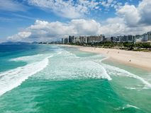 Drone photo of Barra da Tijuca beach, Rio de Janeiro, Brazil. We can see the beach, some building, the boardwalk, the road and the horizon royalty free stock photos