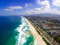 Drone photo of Barra da Tijuca beach, Rio de Janeiro, Brazil. We. Can see the beach, some building, the boardwalk, the road and the horizon royalty free stock photo