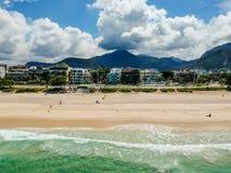 Drone photo of Barra da Tijuca beach, Rio de Janeiro, Brazil. We can see the beach, some building, the boardwalk, the road and the horizon stock photo