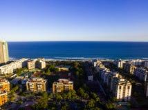 Drone photo of Barra da Tijuca beach, Rio de Janeiro, Brazil. We. Can see the beach, some building, the boardwalk, the road and the horizon stock image