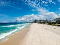 Drone photo of Barra da Tijuca beach, Rio de Janeiro, Brazil. We can see the beach, some building, the boardwalk, the road and the horizon Stock Image