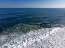 Aerial photo of beach in Barra da Tijuca, Rio de Janeiro, Brazil. Waves crashing with whitewash, creating patterns on the sea. Drone photo of beach in Barra da stock photos