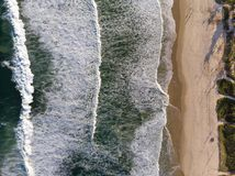Top view Drone photo of beach in Barra da Tijuca, Rio de Janeiro, Brazil. Waves crashing with whitewash, the golden sand and the b. Drone photo of beach in Barra stock images