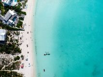 Drone photo of  beach in Sapodilla Bay, Providenciales, Turks an. Drone photo of beach in Grace Bay, Providenciales, Turks and Caicos. The caribbean blue sea and Royalty Free Stock Photo