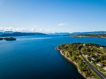 Drone Photo of the Ferry Port in Langfjorden in Norway on a Sunny Summer Day with Mountains and Blue Skies in the Background. Concept of Harmony and Travel royalty free stock images