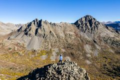 Drone photo - Hikers atop a mountain in the Colorado Rocky Mountains, Sawatch Range. Hikers atop a mountain as seen from a drone. Colorado Rockies stock photo
