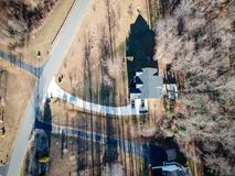 Drone photo of house in Virginia, United States. During winter. Long shadows can be seen, as well as the forest in the back Royalty Free Stock Photo