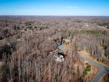 Drone photo of house in Virginia, United States. During winter. Long shadows can be seen, as well as the forest in the back Royalty Free Stock Images