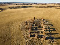 Drone photo of the ruins of an old house in countryside fields. In Small Countryside Village on a Sunny Spring Day Royalty Free Stock Photos