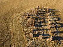 Drone photo of the ruins of an old house in countryside fields. In Small Countryside Village on a Sunny Spring Day Stock Photography