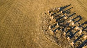 Drone photo of the ruins of an old house in countryside fields. In Small Countryside Village on a Sunny Spring Day Stock Image
