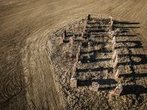 Drone photo of the ruins of an old house in countryside fields -. Drone photo of the ruins of an old house in countryside fields in Small Countryside Village on Royalty Free Stock Images
