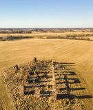 Drone photo of the ruins of an old house in countryside fields. In Small Countryside Village on a Sunny Spring Day Royalty Free Stock Photography