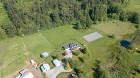 Drone view of single family house. Drone photo of single family house with grey roof and large green grass yard royalty free stock photography