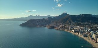 Drone photography coastline of Calpe resort townscape, Spain. Drone top photo coastline of Calpe resort townscape in the Costa Blanca, waterside view, sunny day royalty free stock images