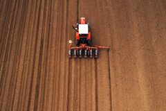 Free Drone Photography Of Tractor With Seeder Working In Field Royalty Free Stock Photos - 176741158