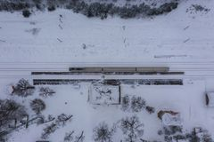Drone photography of winter forest, locomotive in station and railway royalty free stock image