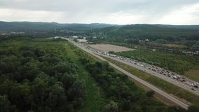 Drone Point of view - traffic at peak hour with cars on the road, over the bridge. Aerial view of freeway busy rush hour heavy traffic jam highway stock video