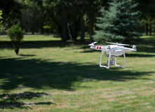 Drone preparing to fly over forest Royalty Free Stock Images